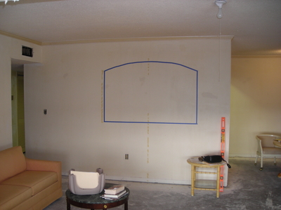 Living Room on Living Room Wall Before Arched Opening To Kitchen Is Made